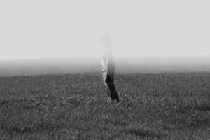 Black and white photo of person in a field