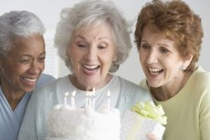 3 Elderly Women with a Birthday Cake