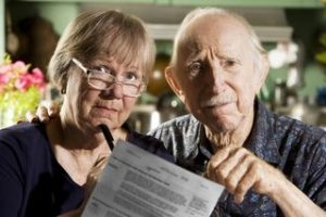 Elderly Couple Looking Worried