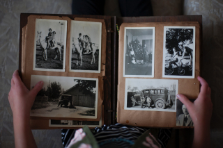 open scrapbook with person reaading it